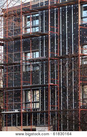 exterior insulation of building facade under construction