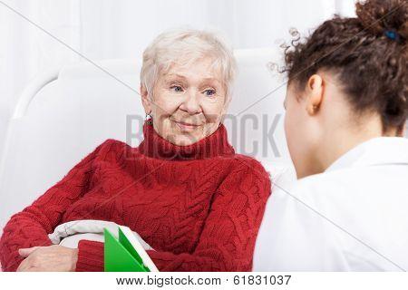 Elderly Lady Listening To Nurse
