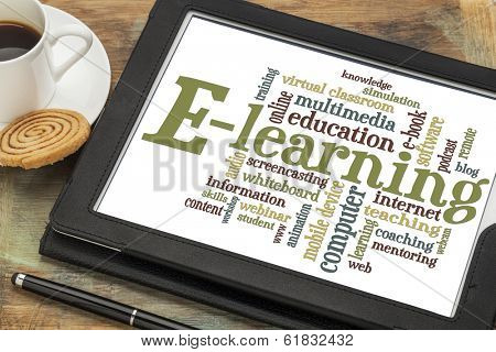 online education concept - e-learning word cloud on a digital tablet with a cup of coffee