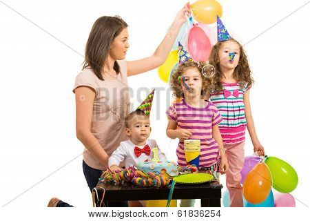 Mother And Kids At Birthday Party