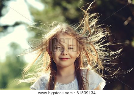 Little girl in the wind