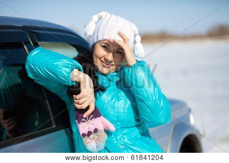 Beautiful Woman In Hat And Mittens