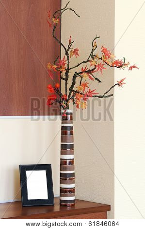 Autumn Arrangement In A Vase On The Table And Photoframe.