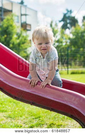 Baby boy on a slide