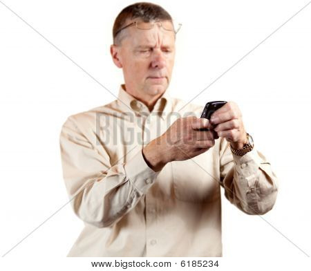 Middle Aged Man Squinting At Smart Phone
