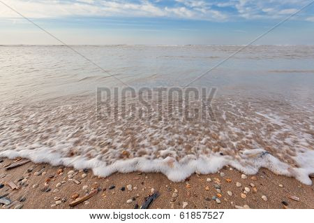 North Sea Waves Ob Sand Beach With Mollusk Shells