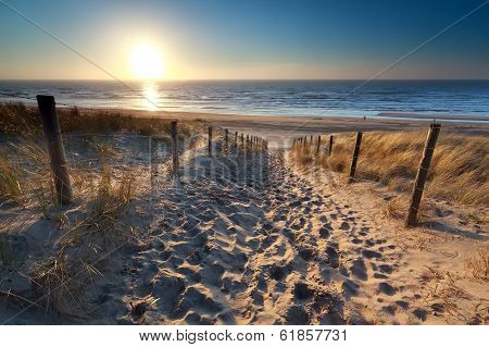Sunshine Over Path To Beach In North Sea