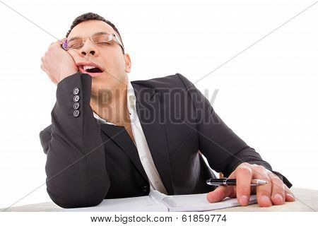 Exhausted Businessman Sleeping At His Desk Yawning