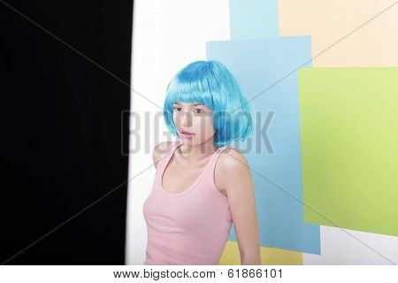 Portrait Of Pensive Beautiful Girl In Fancy Blue Wig And Pink Singlet