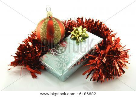 Silver Gift With Tinsel And Bauble