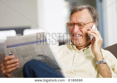 Senior Man Reading Stock Listings