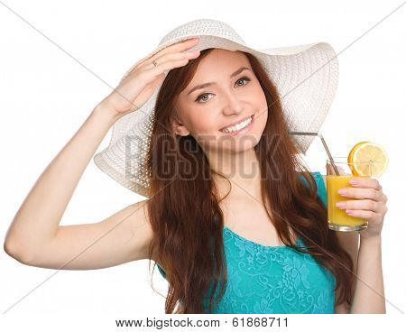 Young woman wearing summer hat and drinking orange juice, isolated over white