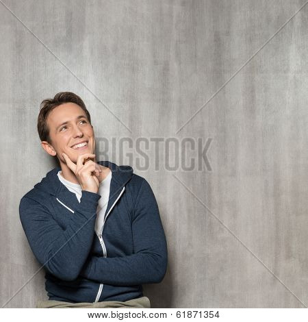 Young Happy Man In Blue Sweatshirt Thinking