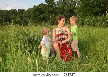 Children Give Mother Flowers