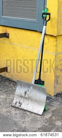 Tools For Territory Cleaning. Shovel And Sweeper Leaned Against A Wall.