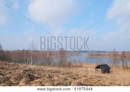 landscape with the image of a bank of  a frozen lake in the spring