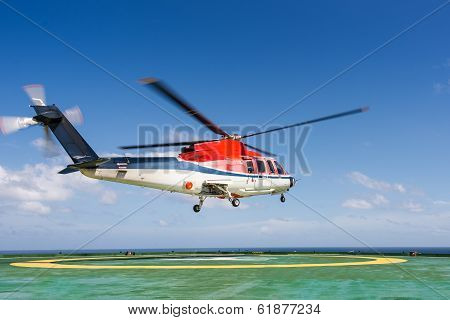 Helicopter taking off from oil rig helipad