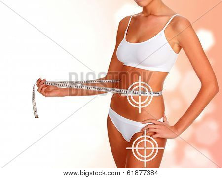 Slim woman with tape measure, weightloss concept