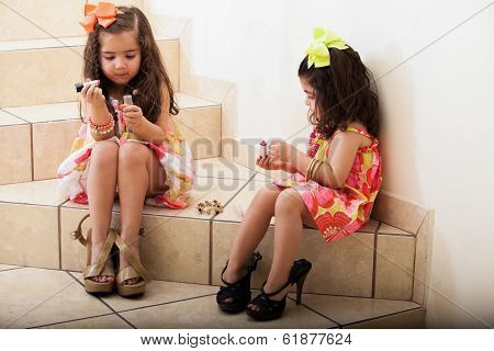 Little girls putting some makeup on