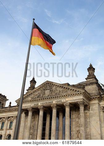Reichstag In Berlin Wih German Flag