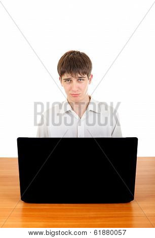Sad Teenager Behind Laptop
