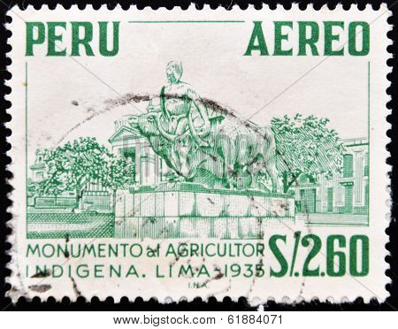 PERU - CIRCA 1935: A stamp printed in Peru shows monument to the indigenous farmer circa 1935