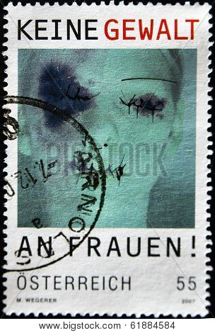 AUSTRIA - CIRCA 2008: A stamp printed in Austria shows a face of a woman with cuts and bruises
