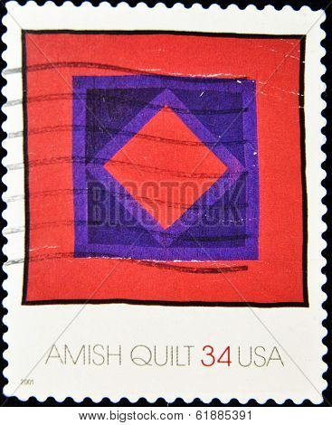 UNITED STATES OF AMERICA - CIRCA 2001: A stamp printed in USA shows a amish quilt circa 2001