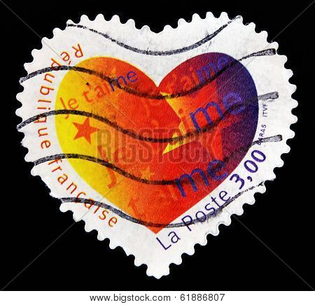 FRANCE - CIRCA 2003: A Heart Shaped Stamp with the word love you in French circa 2003