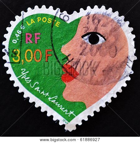 FRANCE - CIRCA 2000: A stamp printed in France that shows heart of Yves Saint Laurent with a woman