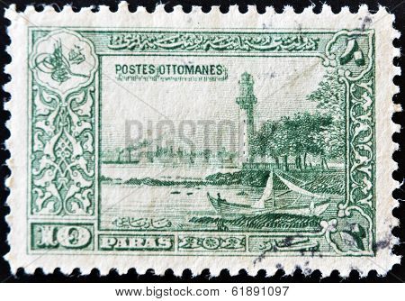 TURKEY - CIRCA 1915: A stamp printed in Turkey shows seascape with lighthouse circa 1915
