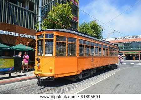 SAN FRANCISCO, CA - AUGUST 16, 2013: Cable Car in San Francisco downtown. Cable cars are oldest mechanical public transport in San Francisco which is in service since 1873.