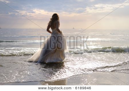 Bride Walking Along Sea Coast