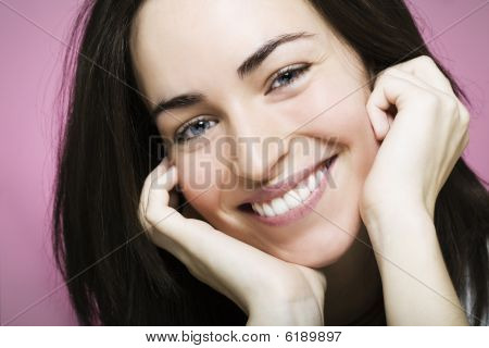 Happy Young Girl Smiling And Laughing
