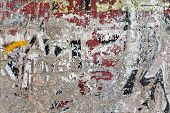 stock photo of scrape  - Used wall with alot of scraping multicolor painting - JPG