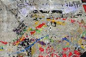 foto of scrape  - Used wall with alot of scraping multicolor painting - JPG