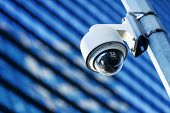 stock photo of security  - close up of security camera and urban video - JPG