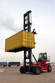 picture of spreader  - Mobile container handler in action at a container terminal - JPG