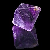 pic of peridot  - Purple Violet Fluorite with reflection on black surface background - JPG