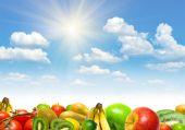 image of fruits vegetables  - Collage from fruits and vegetables against blue summer cloudy sky - JPG