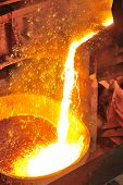 picture of ferrous metal  - Pouring of liquid metal in open hearth workshop - JPG
