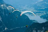stock photo of parachute  - Parachuting in the high Austria Alps mountains - JPG