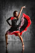 stock photo of samba  - young beautiful dancer posing on studio background - JPG