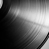 stock photo of turn-up  - Black vinyl record close up - JPG