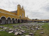 stock photo of yucatan  - the monastery of Izamal with lots of folding chairs after a event in Yucatan Mexico - JPG