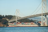 Cargo Ship Under San Francisco Bay Bridge
