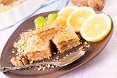 image of baklava  - Traditional Turkish sweet baklava stuffed with walnuts and honey - JPG