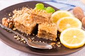 stock photo of baklava  - Sweet traditional Turkish baklava with walnuts and homey - JPG