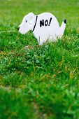 image of dog poop  - No Pooping On The Grass Sign Shaped Like A Dog - JPG