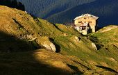 picture of chalet  - Mountain chalet in sunset light - JPG